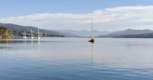 A yacht at anchor in the calm waters of the Southern Trove south of Hobart